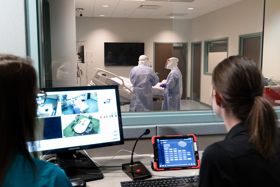 Students train in PPE in simulated biocontainment unit