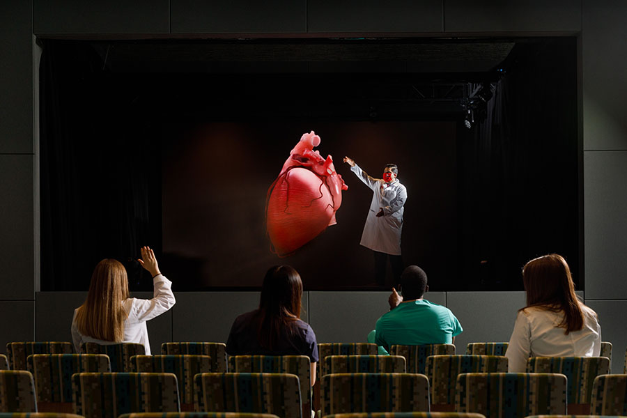 Students view a hologram of a heart in Davis Global Center's holographic theater