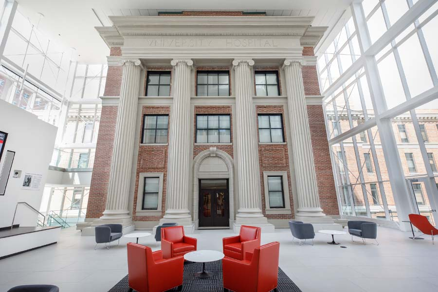 View of the glass atrium of the Wigton Heritage Center, which encloses the original front columns of University Hospital