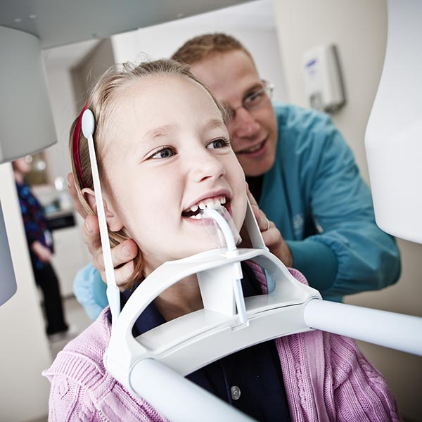 Dentistry student with a young patient