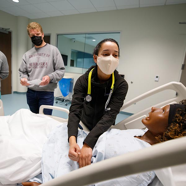 Medical students work with a simulator